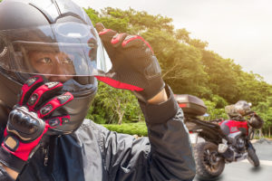Man with Motorcycle - Motorcycle accident in Minnesota - Sand Law LLC