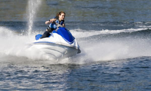 woman rides jet ski - Minnesota Recreational Accidents - Sand Law LLC